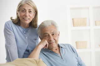 Elderly couple looking forward