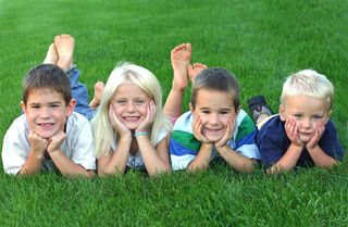 4 kids in grass