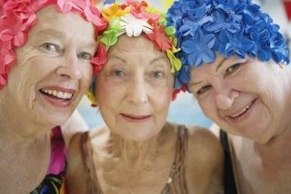 3 elderly ladies in swim caps