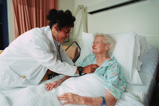 Elderly person in hospital bed