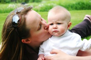 Mom kissing a baby